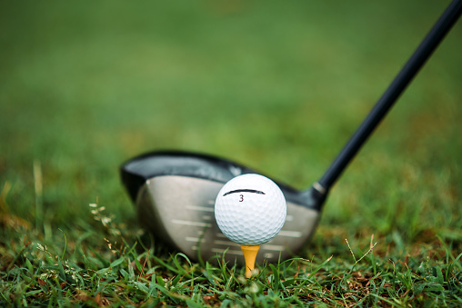 Taking a Shot - Sport「Close up of Golf ball with driver club on the golf course」:スマホ壁紙(14)