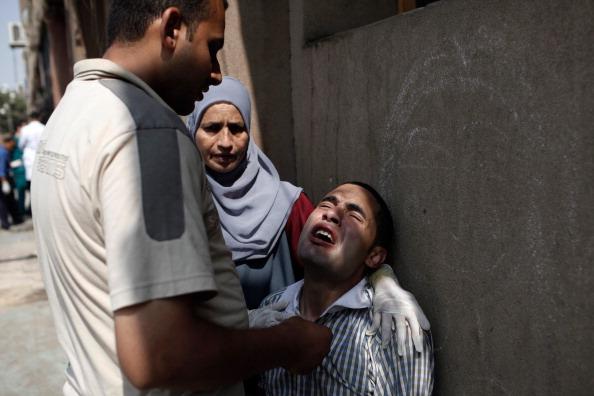 Giles「Pro-Morsi Supporters Killed In Shooting Incident Outside Presidential Guard Barracks」:写真・画像(14)[壁紙.com]