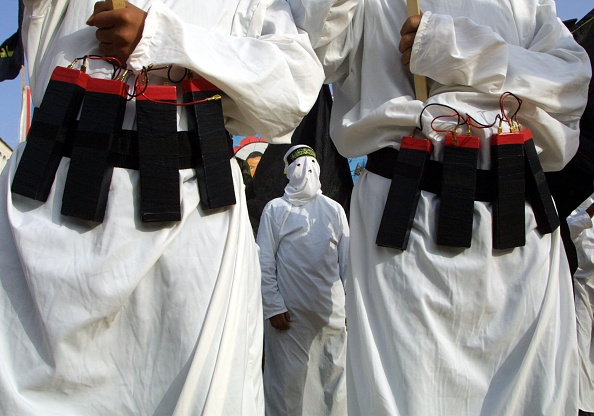 Suicide Bombing「Masked Islamic Jihad Militants Wear Explosive Belts During A Rally Commemorating Mohammed...」:写真・画像(11)[壁紙.com]
