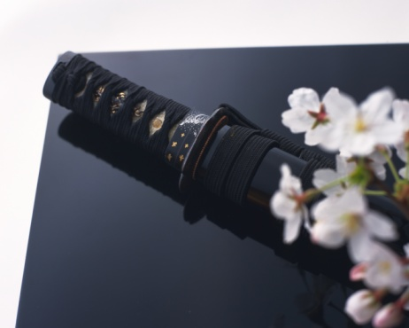 Tradition「Japanese sword and cherry flowers on black surface, high angle view, white background, differential focus」:スマホ壁紙(15)