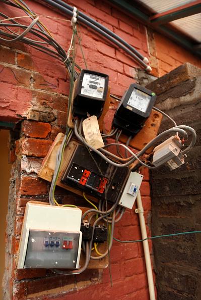 Brick Wall「Electricity fuse boxes and meters requiring repair, UK」:写真・画像(8)[壁紙.com]