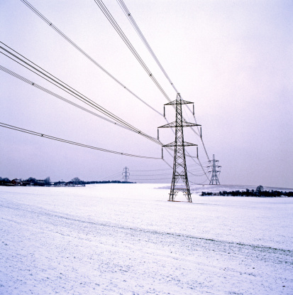 Electricity Pylon「Electricity pylons across snow-covered landscape」:スマホ壁紙(8)