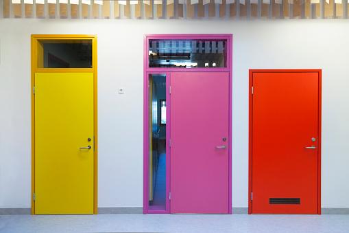 Closed「Estonia, coloured doors of a newly built kindergarten」:スマホ壁紙(15)