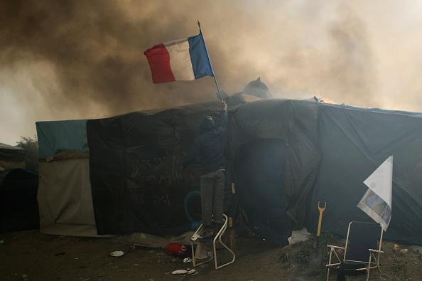 Calais「Migrants Leave The Jungle Refugee Camp In Calais」:写真・画像(7)[壁紙.com]