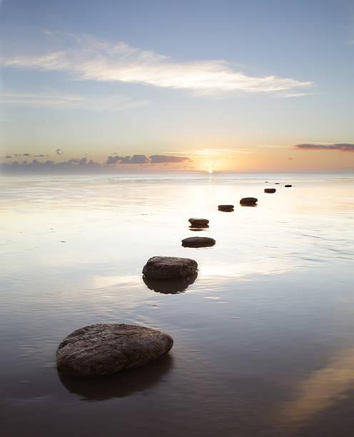 Stepping stones over water at sunrise:スマホ壁紙(壁紙.com)