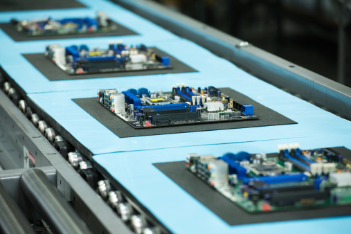 Mother Board「motherboards on conveyor in manufacturing facility」:スマホ壁紙(2)