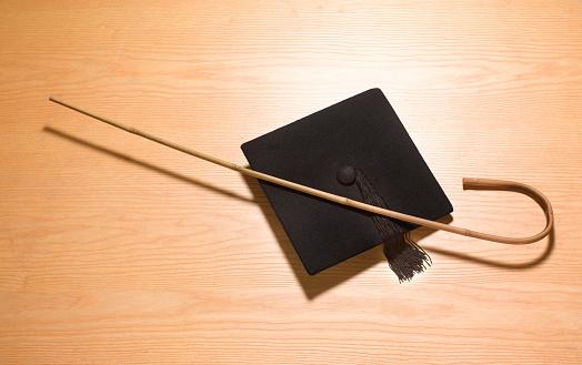 Graduation「Mortarboard and cane corporal punishment」:スマホ壁紙(12)