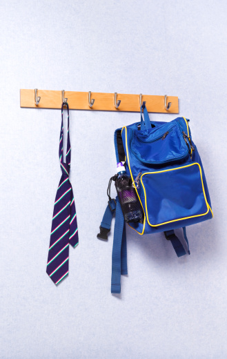 Well-dressed「Tie and bag hanging in a school classroom」:スマホ壁紙(5)