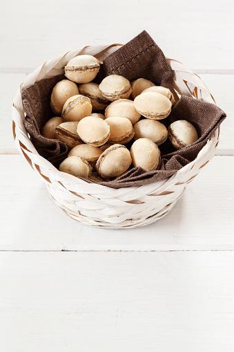 イースター「Basket of waffle eggs on white wood」:スマホ壁紙(13)