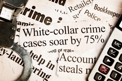 Thief「Handcuffs and calculator on headlines about white collar crime」:スマホ壁紙(14)