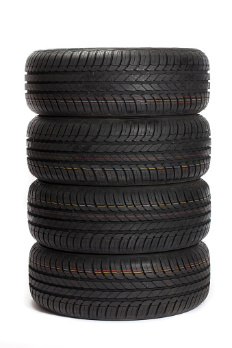 Motorsport「Four black car tires stacked on top of one another」:スマホ壁紙(15)