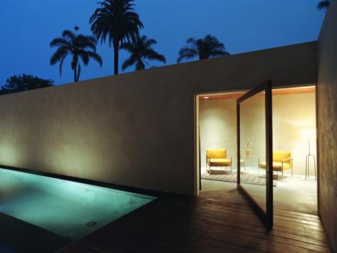 フレンチドア「Living room and lap pool of modern house, nighttime」:スマホ壁紙(16)