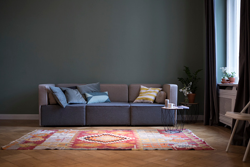 Sofa「Living room with couch and carpet」:スマホ壁紙(7)