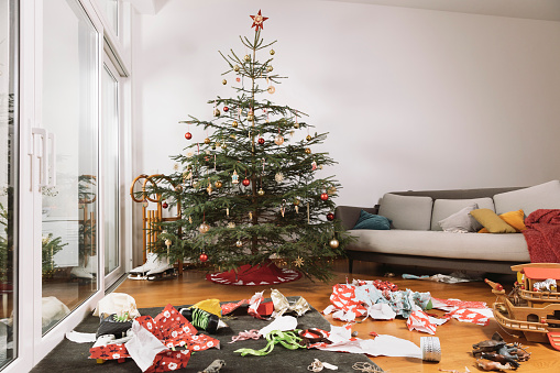 Wrapped「Living room on Christmas morning with torn up wrapping paper in front of the tree」:スマホ壁紙(9)