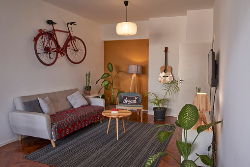 Cool「Living room with vintage bicycle hanging on the wall」:スマホ壁紙(13)