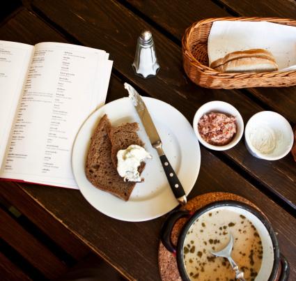 Guidebook「Eaten food & travel guide on table, overhead view.」:スマホ壁紙(8)