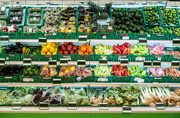 Stand with fruits and vegetables in the supermarket:スマホ壁紙(壁紙.com)