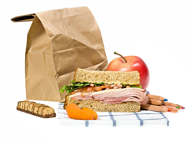 School lunch next to brown paper bag on a white background:スマホ壁紙(壁紙.com)