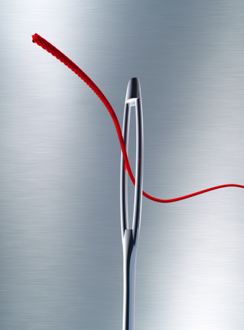 Sewing「Sewing needle with a red thread through the eye」:スマホ壁紙(8)