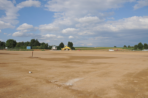Construction Vehicle「New construction site empty levelled ground farmland soil sealing」:スマホ壁紙(9)