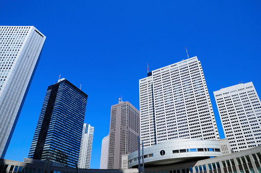Low Angle View「Skyscrapers Against Blue Sky」:スマホ壁紙(0)