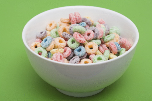 Green Background「Bowl of colorful cereal rings」:スマホ壁紙(1)