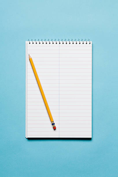 Single yellow sharpened pencil with blank stenographer notebook on blue background:スマホ壁紙(壁紙.com)