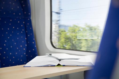 Portability「Book and digital tablet in a train」:スマホ壁紙(16)