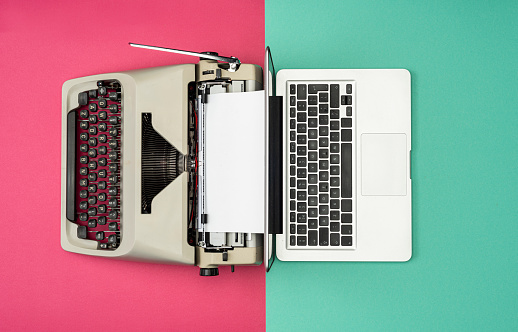 Green Background「Classic analog typewriter vs Modern digital hi-tech laptop computer」:スマホ壁紙(7)