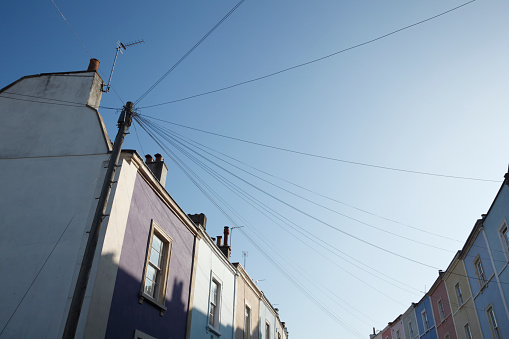 Telephone Pole「Telegraph Pole and wires connected to a multicolour row of terraced houses.」:スマホ壁紙(14)