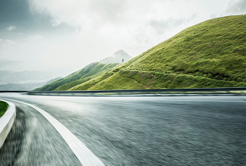 Empty Road「empty road travel through mountain range,blurred motion」:スマホ壁紙(1)