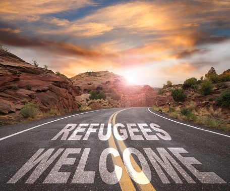 A Helping Hand「Empty Road with REFUGEES WELCOME text at Sunrise」:スマホ壁紙(16)