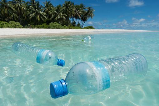 Island「Plastic bottles floating in sea off tropical island」:スマホ壁紙(11)