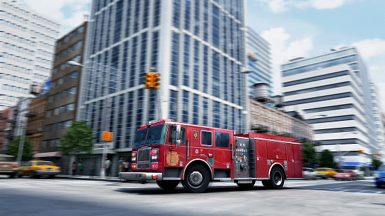Low Angle View「Blurred view of fire truck driving through intersection, New York, New York, United States」:スマホ壁紙(17)