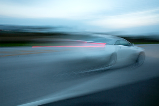 Gulf Coast States「Blurred view of car driving on road」:スマホ壁紙(5)