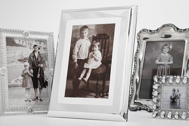 cropped group of framed vintage family photographs:スマホ壁紙(壁紙.com)