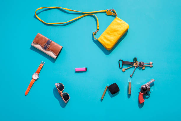 Purse, wallet, gun and accessories on blue background:スマホ壁紙(壁紙.com)