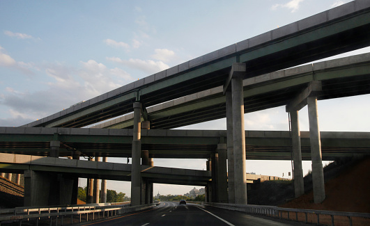 Elevated Road「highway ramps and cement columns with car」:スマホ壁紙(3)