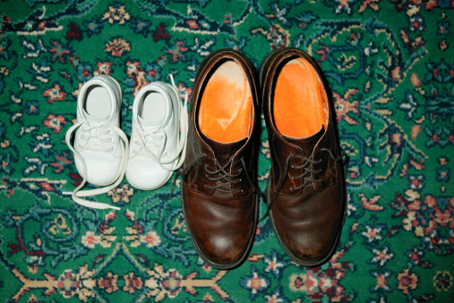 父親「Baby sneakers on the carpeted floor next to a pair of man's dress shoes.」:スマホ壁紙(11)