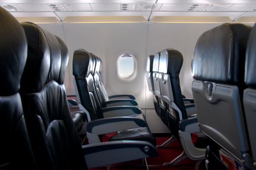 Airplane Seat「Premium Economy Class Seating Inside An Airplane Cabin」:スマホ壁紙(7)