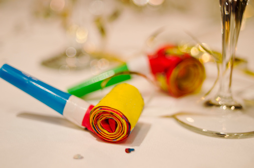 お正月「Party horn blower and champagne flute on table, close-up」:スマホ壁紙(11)