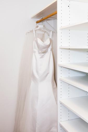 Gulf Coast States「Bride's dress hanging in closet」:スマホ壁紙(5)