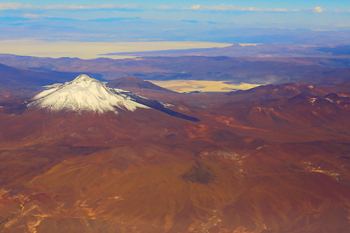 Bolivian Andes「Atacama Desert – Chilean, Argentinean and Bolivian Andes aerial view – above dramatic snowcapped pastel colored landscapes, exotic volcanoes and Idyllic Atacama Desert, Volcanic landscape panorama –  Chile, Bolivia and Argentina border」:スマホ壁紙(1)