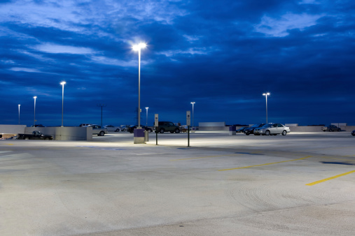 Parking Lot「Nearly Empty Concrete Parking Lot At Dusk」:スマホ壁紙(2)