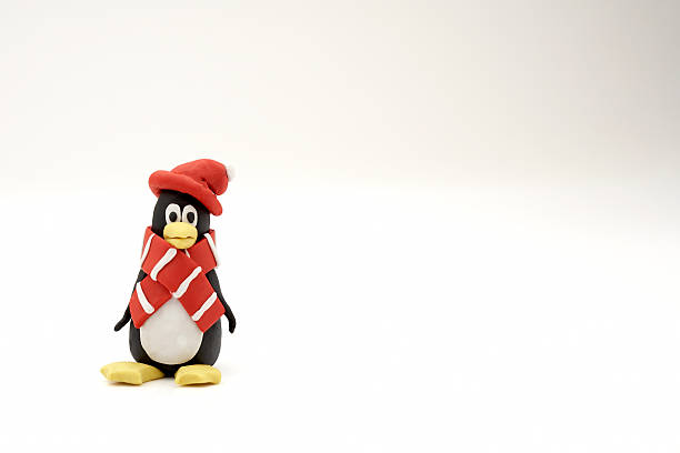 Penguin with scarf  and hat made of clay on a white background:スマホ壁紙(壁紙.com)