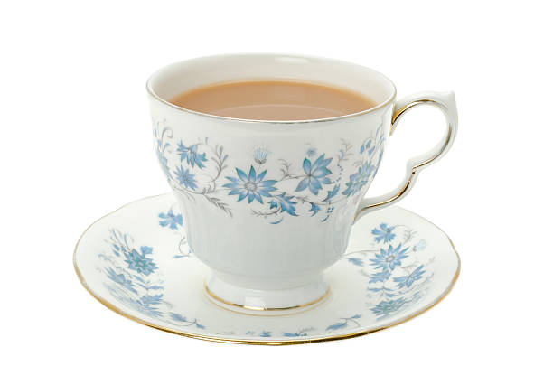 Hot tea served in a bone china cup and saucer:スマホ壁紙(壁紙.com)