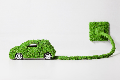Cable「Electric car covered with grass connected to socket, close up」:スマホ壁紙(7)