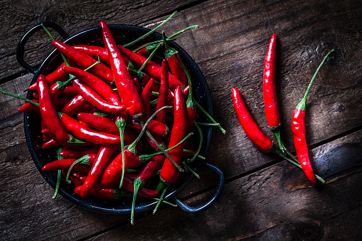 Chili Pepper「Red chili peppers shot from above on rustic wooden table」:スマホ壁紙(4)