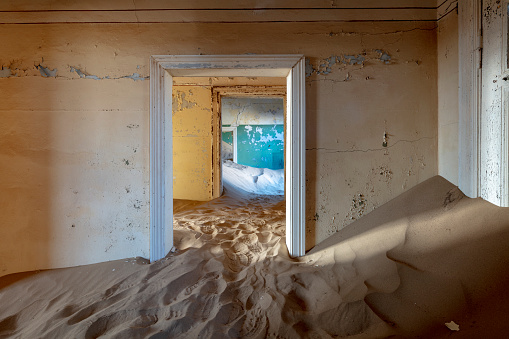 Namibia「Doorway in a sand-filled house in Kolmanskop - a remote, former diamond-mining ghost town near Luderitz in southwestern Namibia」:スマホ壁紙(18)