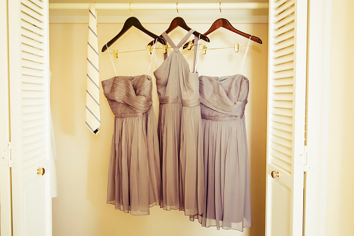 Dress「Bridesmaid dresses hanging in closet」:スマホ壁紙(8)